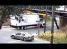 Speeding truck pops a wheelie at the 11foot8 bridge