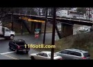 Flatbed truck loses load at the 11foot8 bridge