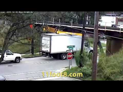 Another reefer truck stuck under the 11foot8 bridge