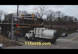 Industrial vacuum truck smashes into the 11foot8 bridge