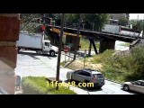 Boxtruck gets peeled open and stuck at the 11foot8 bridge