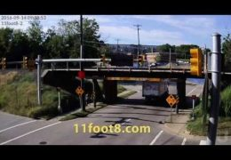 Reefer truck just barely escapes from the 11foot8 bridge