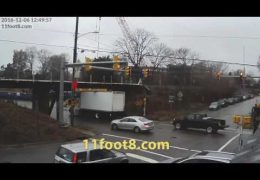 Boxtruck gets jammed under the 11foot8 bridge