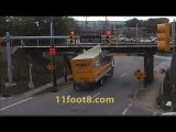 Speeding truck runs light and pops a wheelie at the 11foot8 bridge