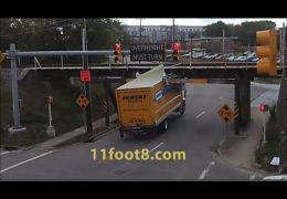 Speeding truck runs light and pops a wheelie at the 11foot8 bridge