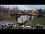 Pedestrian dodges truck crash debris at the 11foot8 bridge