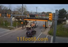 Crane truck almost defeats the 11foot8+8 bridge
