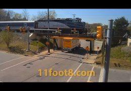 Rental boxtruck gets stuck as train crosses the 11foot8+8 bridge