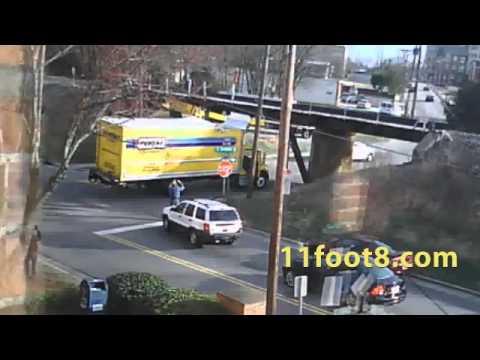 Rental truck hits bridge and crash debris damages SUV