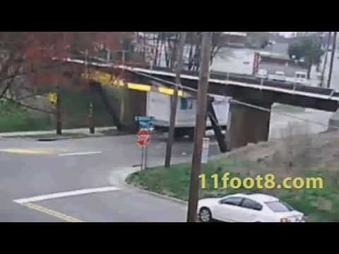 Truck rips back off at the 11foot8 bridge