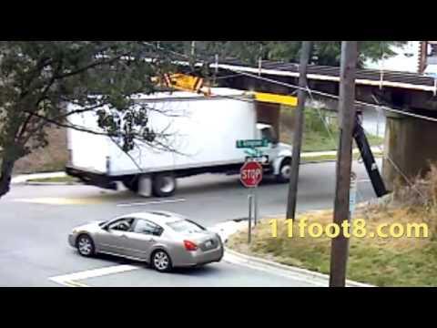 Speeding truck pops a wheelie at the 11foot8 bridge