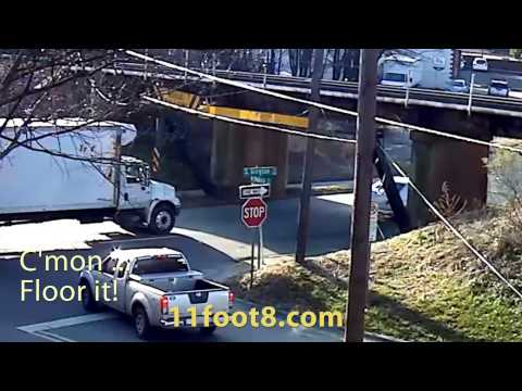 Truck driver hesitates and then hits the 11foo8 bridge anyway