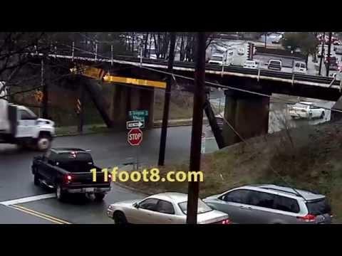 Flatbed truck loses load at the 11foot8 bridge