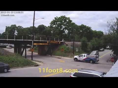 Dumpster truck's tarp cover hits 11foot8 bridge