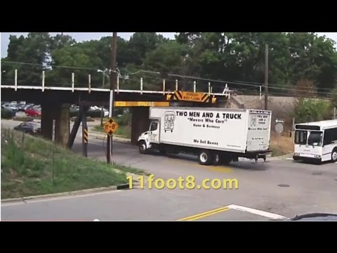 Two men and a truck that almost fit under the 11foot8 bridge