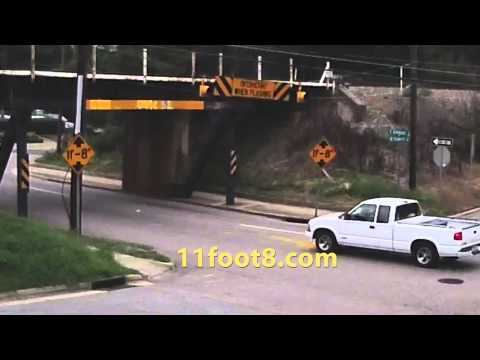 Truck driver makes a bad move at the 11foot8 bridge