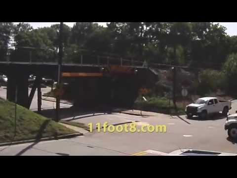 Reefer truck scrapes top at the 11foot8 bridge