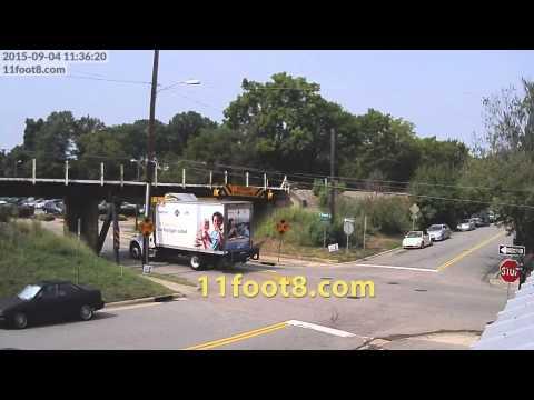 Walmart truck hits 11foot8 bridge