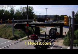 Log truck bumps into the 11foot8 bridge