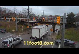 Pedestrian dodges truck crash debris at the 11foot8 bridge