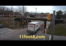 Pedestrian escapes reefer truck carnage at the 11foot8 bridge