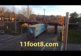 Speeding semi gets smashed up at the 11foot8 bridge