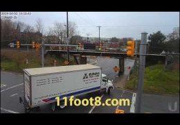 Two trucks tango at the 11foot8 bridge