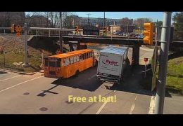 Boxtruck wrestles with 11foot8 bridge while train crosses