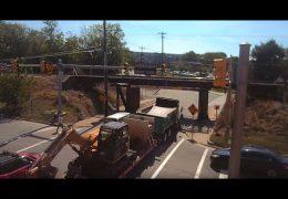 "Excavator on trailer ""bites"" back at the 11foot8 bridge"