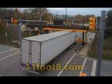 Semi truck gets fairing stuck at the 11foot8+8 bridge