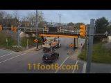 Crane truck almost defeats the 11foot8+8 bridge