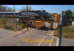 Rental boxtruck gets stuck as train crosses the 11foot8+8 bridge