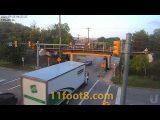 Rental truck crash debris hits innocent vehicle at the 11foot8+8 bridge